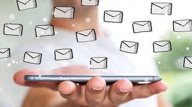 Businessman holding emails sketch over mobile phone