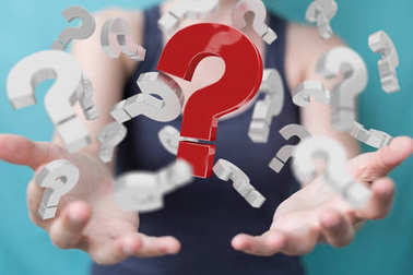 Businesswoman using 3D rendering question marks