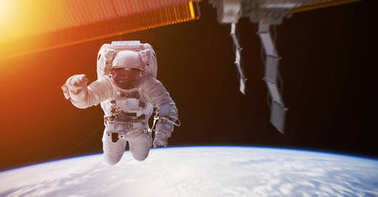 Astronaut working on a space station 3D rendering elements of th