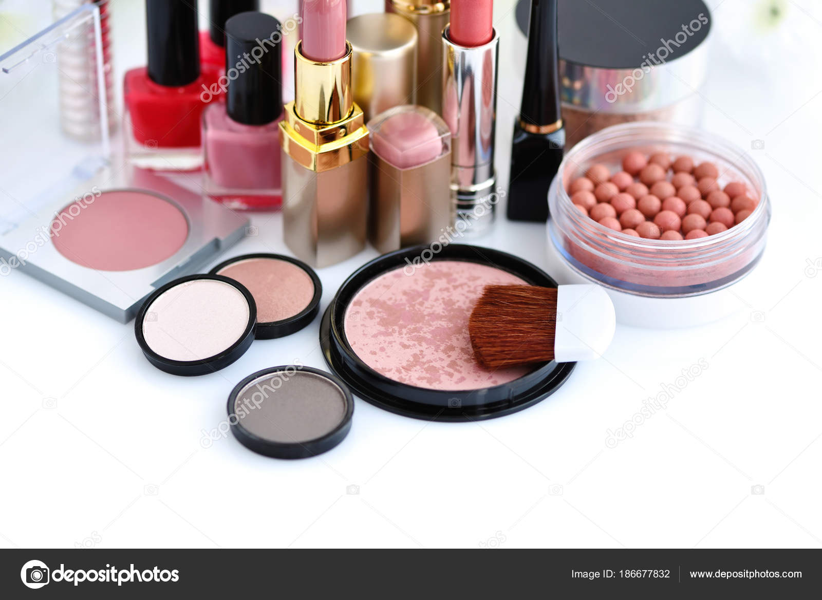 Set of decorative cosmetic: powder, lipsticks, brush, blush ...