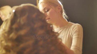 Make-up artist putting on make-up on models eyes.Eyelids make-up close up shot.
