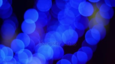 Blue bokeh on a black background, slow hitting of the camera, 4k