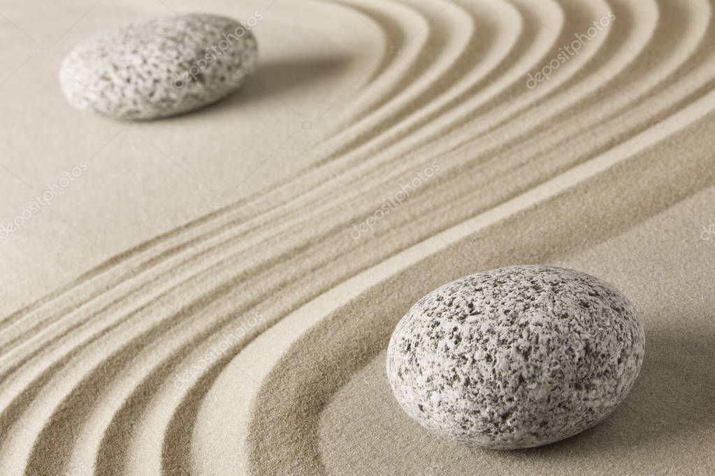 Yin and yang stones and sand pattern