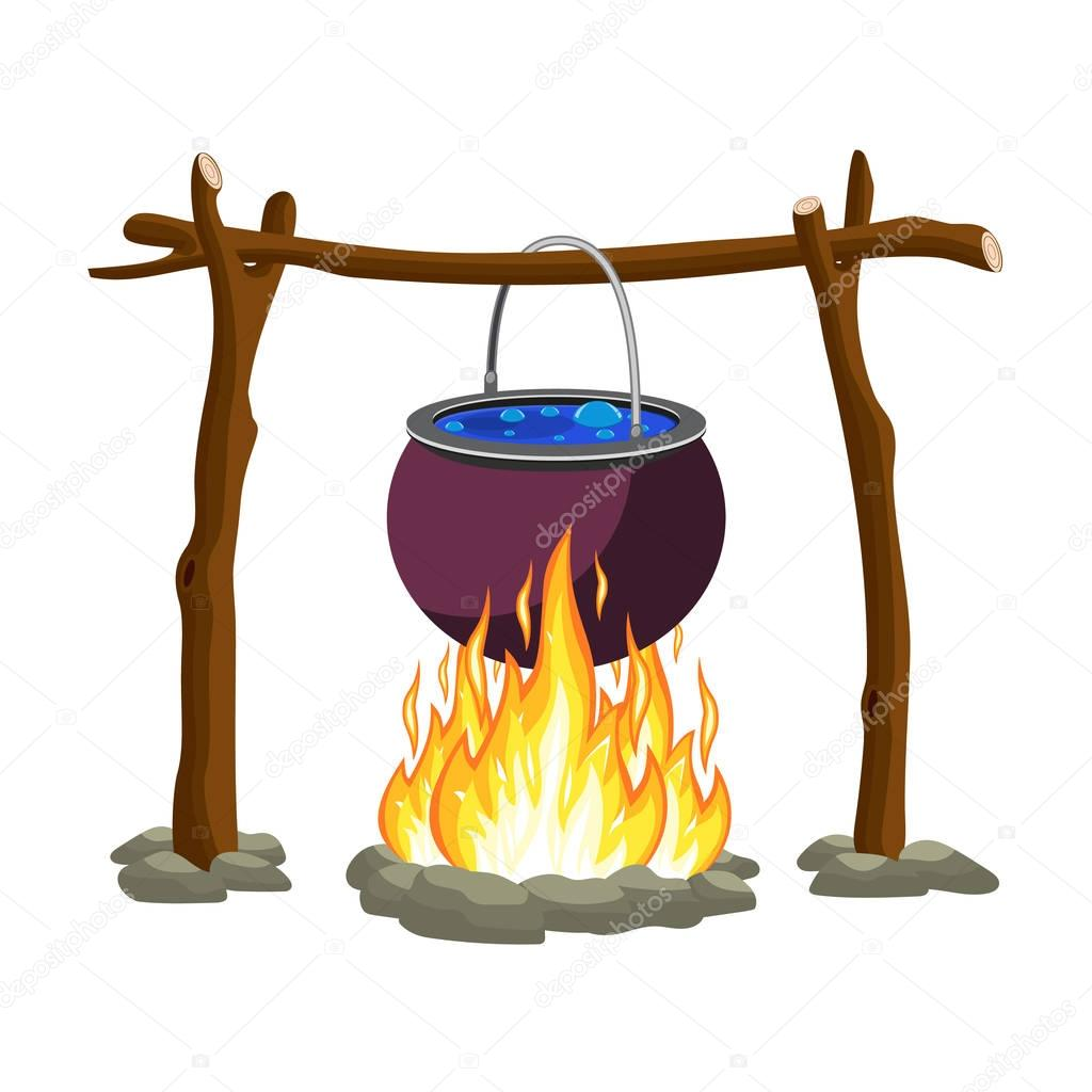 Black camping pot over a bonfire