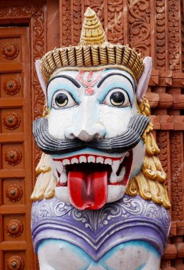Closeup of tiger as dwara pala or guard in Hindu temple entrance