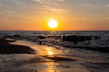 Sunset. Beautiful sunset at baltic sea. Gold sea sunset. background.