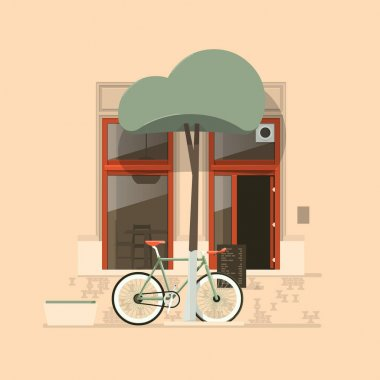 Bicycle in front of a cafe shop