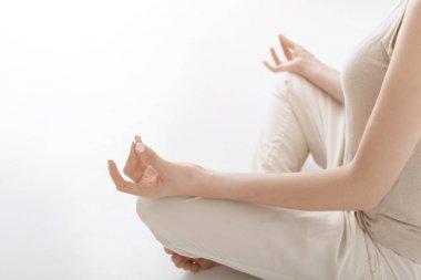 Woman meditating at home. Girl practicing yoga