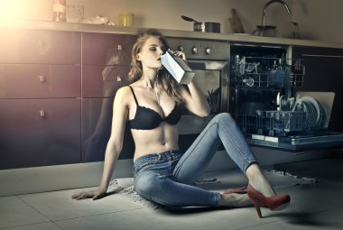 woman is drinking milk