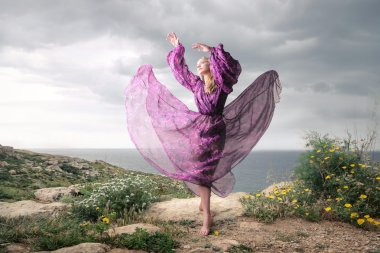 dancing woman in purple clothes