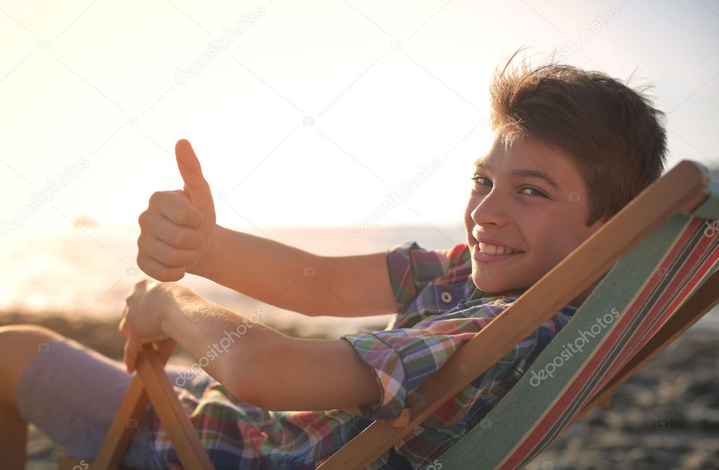 smiling guy in a deck chair