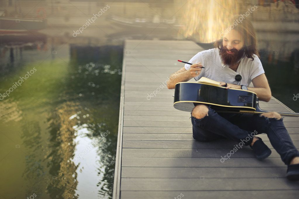 bearded man with a guitart