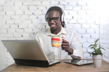 Black businessman with headphone