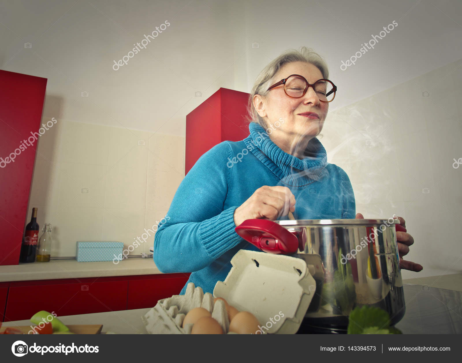 Passionate older lady in kitchen — Stock Photo © olly18 #143394573