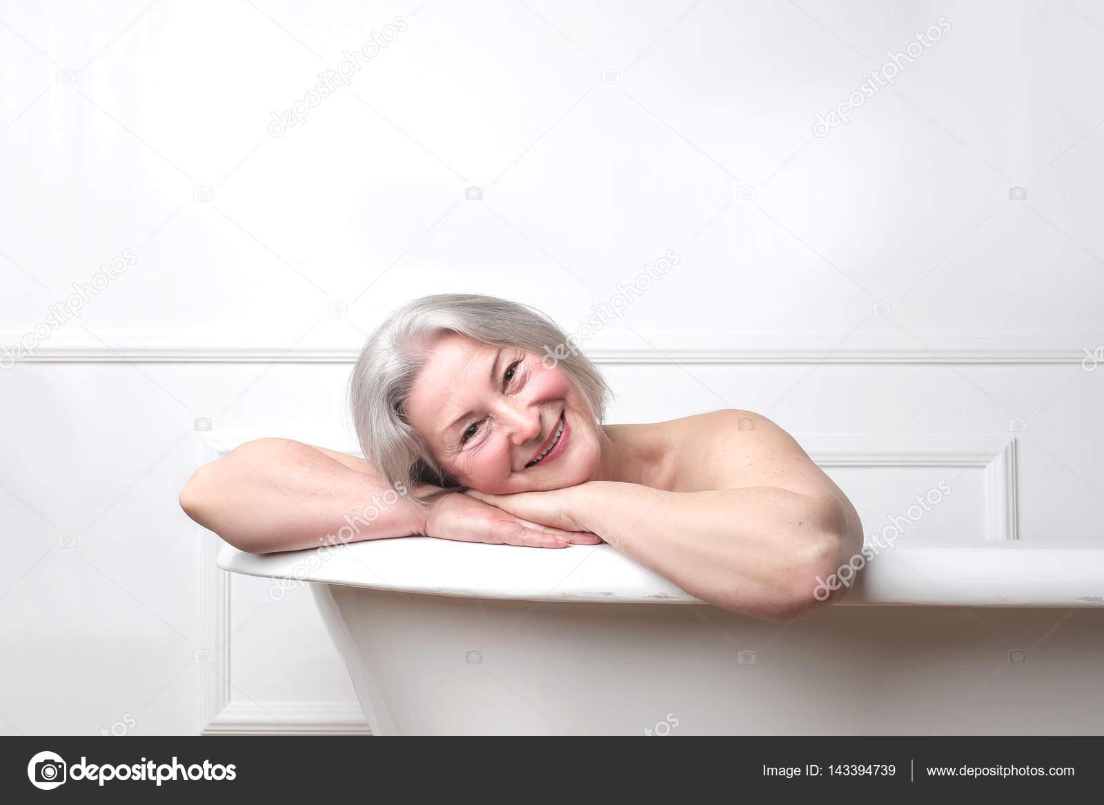 Older lady in bathtub — Stock Photo © olly18 #143394739