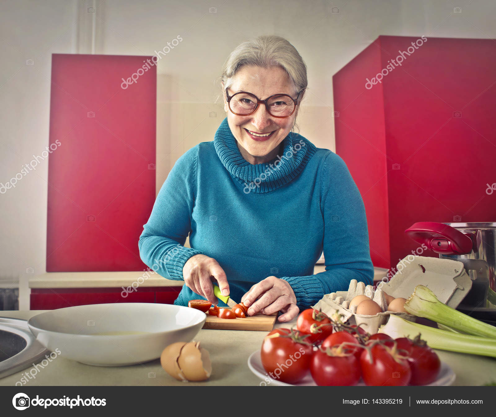 Older lady cutting vegetables — Stock Photo © olly18 #143395219