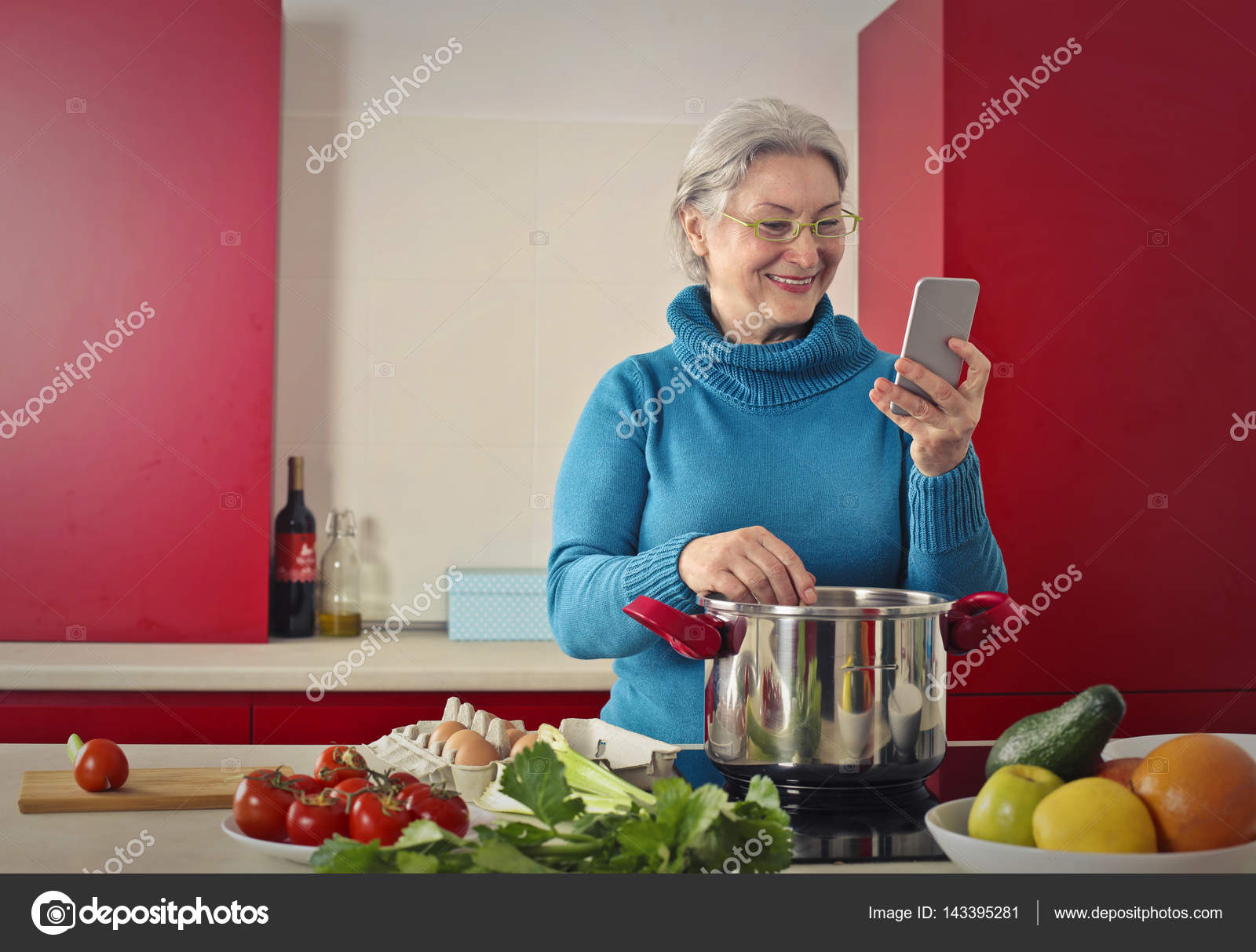 Lady cooking and telephoning — Stock Photo © olly18 #143395281