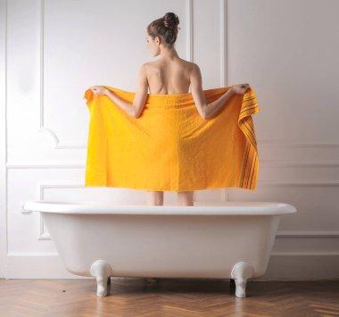 Woman in orange towel