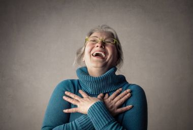Old lady in glasses laughing inside