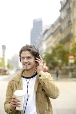 Guy with drinking and listening to music