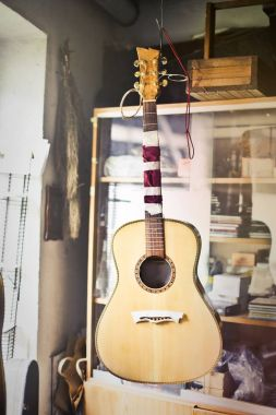 Acoustic guitar in a lutist laboratory