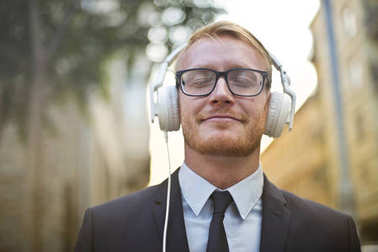 Businessman listening to music with headphones