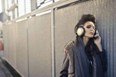 Girl listening to music with headphones outdoor