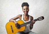 Fotografie Girl playing acoustic guitar