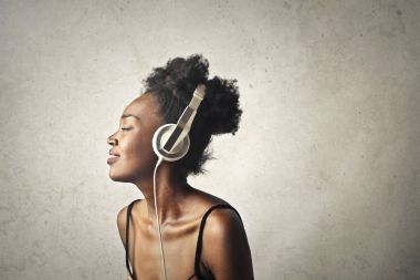 Portrait of a girl listening to music