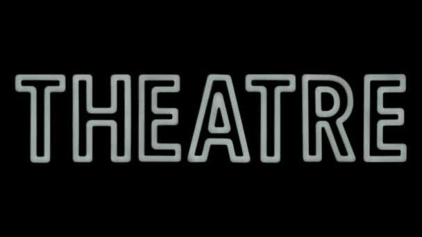 Blikající růžový neon znamení pro divadlo na černém pozadí