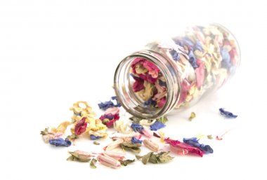 Colourful Potpourri in a jar on a white background