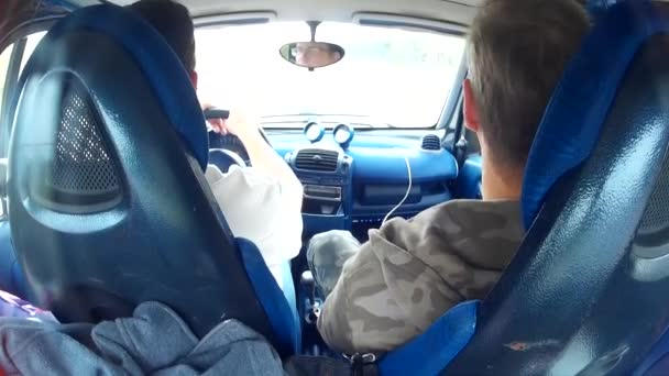Two men doing test drive of used car
