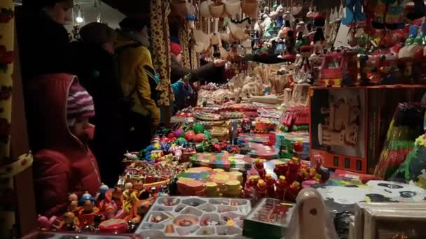 People visit Christmas market at main square in old city