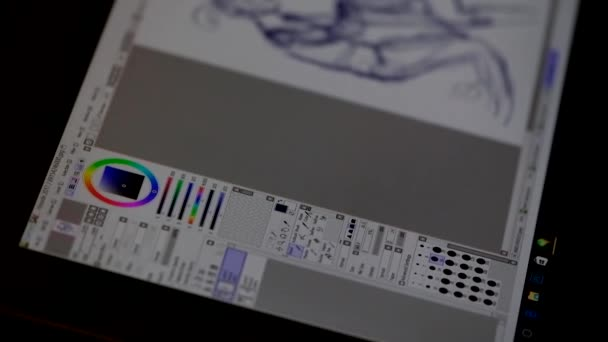 Artist draws on the screen of a tablet pc