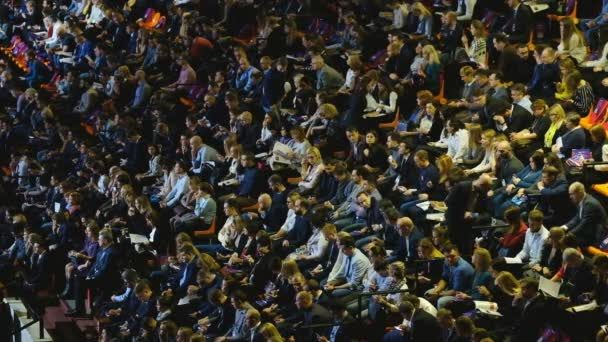 People attend business conference in congress hall at Synergy Global Forum