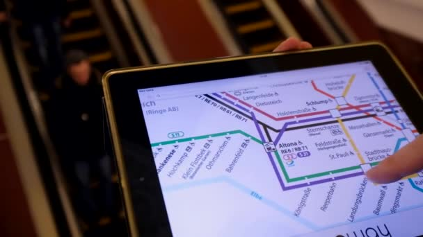 Man Looking At Subway Map.Man In Underground Examines The Subway Map Using The Tablet