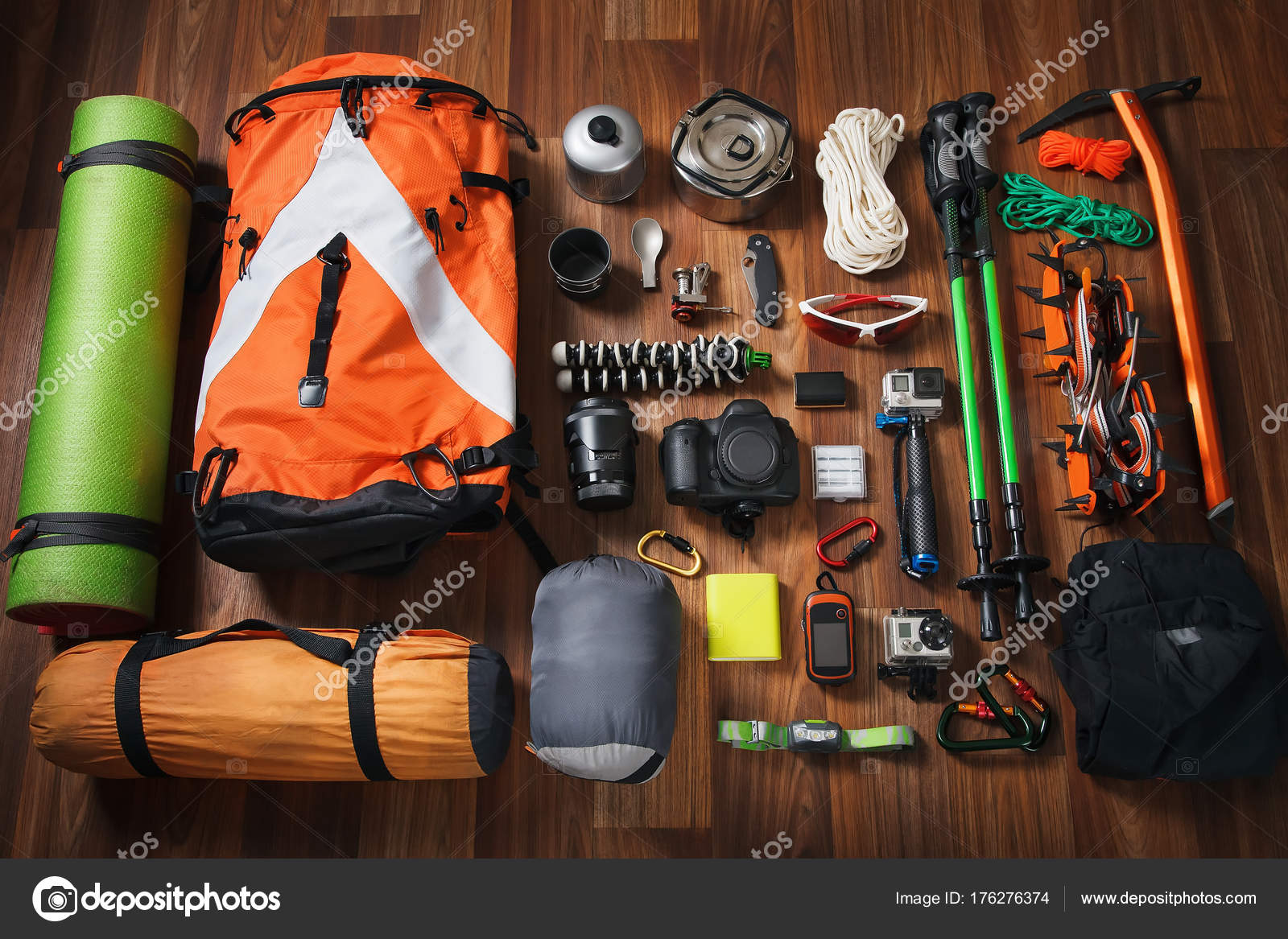 ed2c46b81c8aa3 Equipment for mountaineering and hiking on wooden background ...