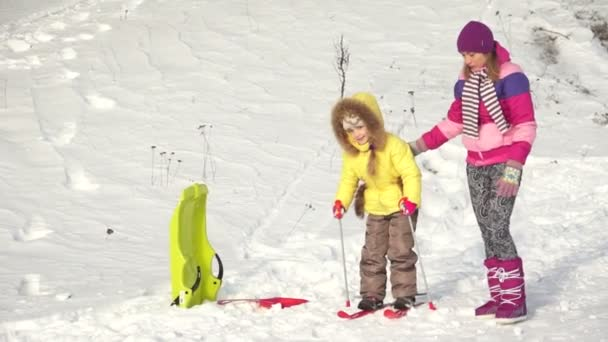 Child learning to ride a skisChild learning to ride a skis