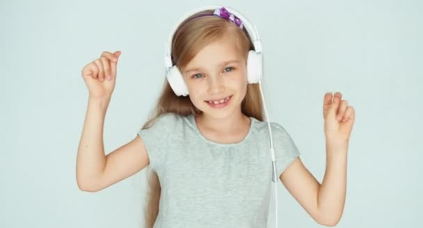 Girl listening to music with headphones on a white background