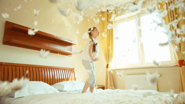 Girl jumping and spinning on the bed