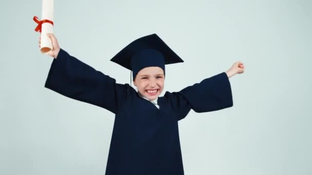 Happy student graduate girl 7-8 years child has diploma on white