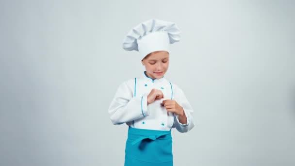 Szakács szakács gyermek 7-8 év preens állandó elszigetelt fehér background