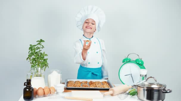 Little chef cook holding biscuit