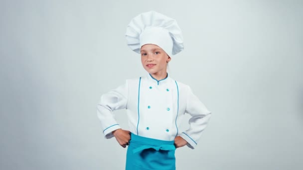 Portrait chef cook child 7-8 years showing okey at camera standing isolated on white background