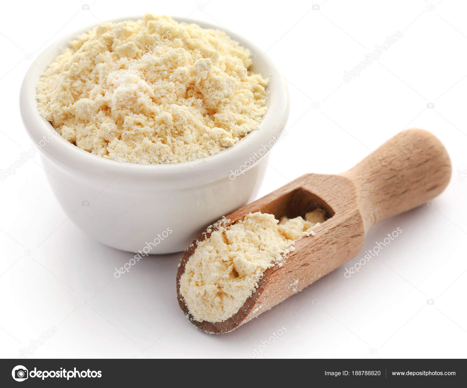 Gram flour in bowl and wooden scoop — Stock Photo © bdspn74