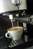 Coffee machine pouring coffee