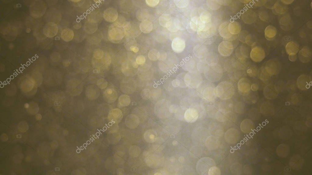 Abstract golden background with beautiful flickering particles. Underwater bubbles in flow with bokeh