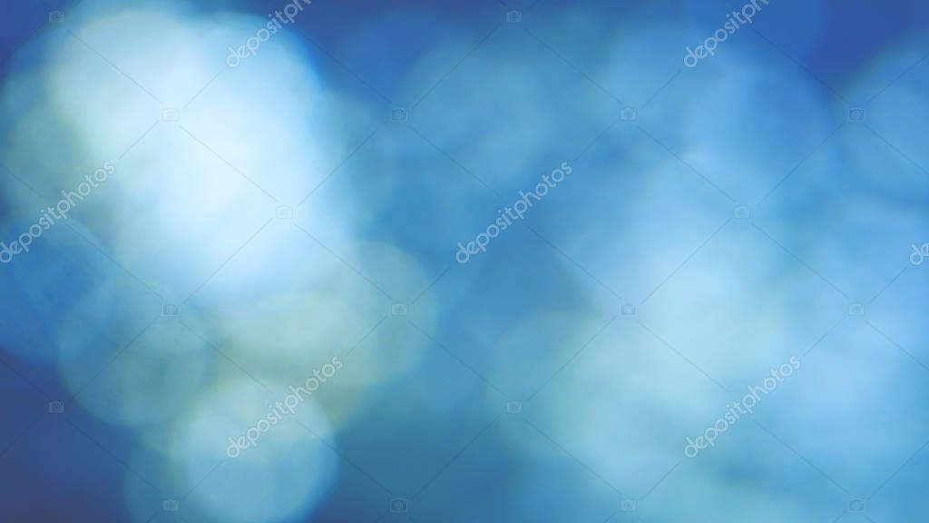 Abstract blue background with beautiful flickering particles. Underwater bubbles in flow with bokeh