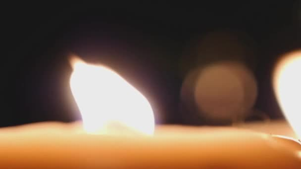 Candle burning with bokeh lights on the background. Romantic candles. 1920x1080