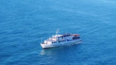 Aerial shot of luxury cruise boat sailing at blue sea in slow motion. 3840x2160